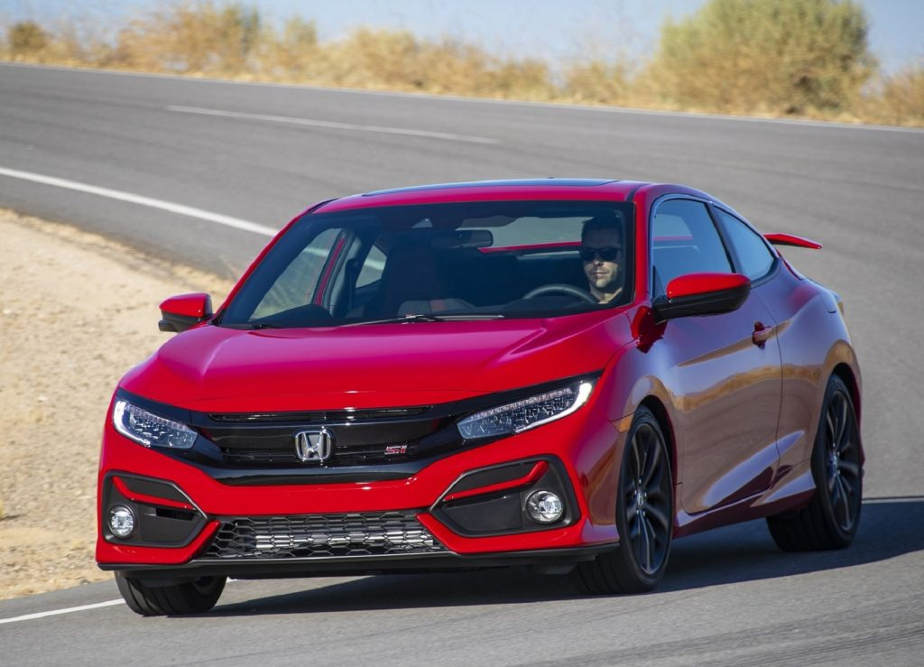Red 2020 Honda Civic Si Coupe driving around a corner