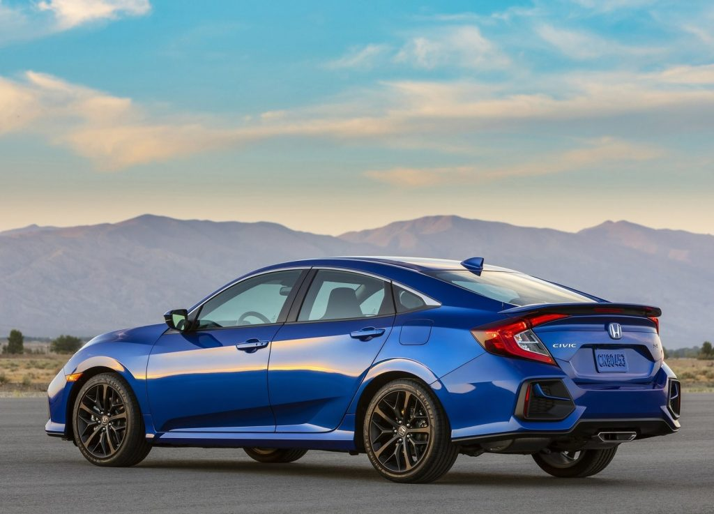 Rear side view of a blue 2020 Honda Civic Si Sedan