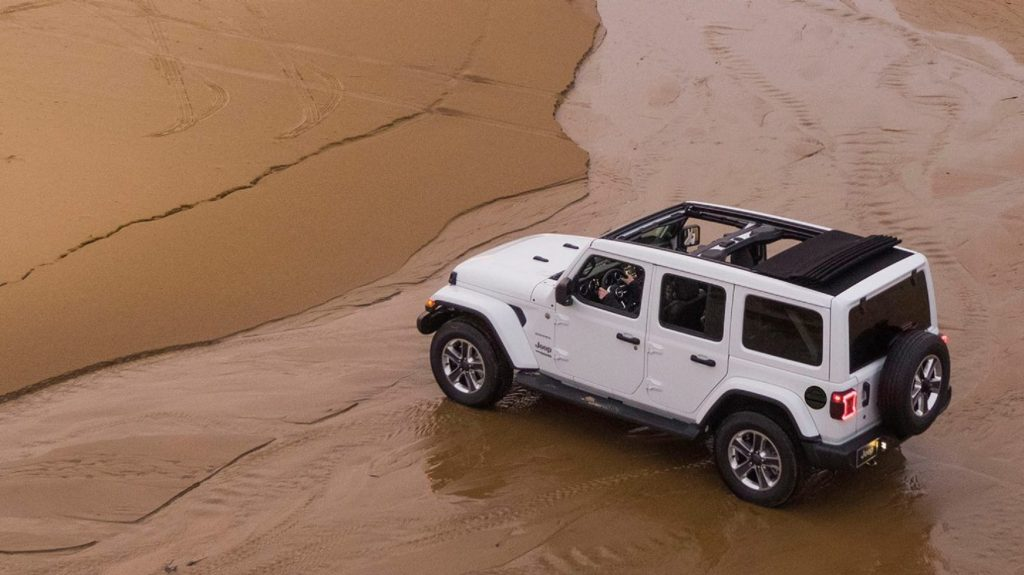 Overhead view of the 2020 Jeep Wrangler Sahara on a beach