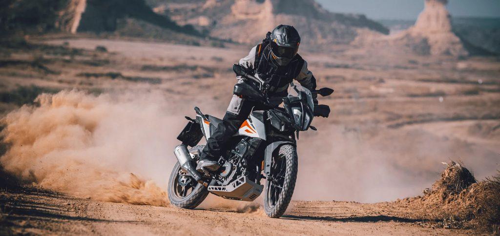 2020 KTM 390 Adventure motorcycle sliding through the desert