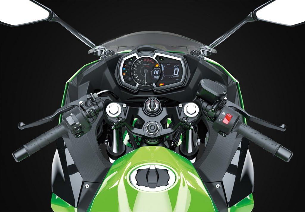 Green 2020 Kawasaki Ninja 400 rider perspective view, showing digital display and handlebars