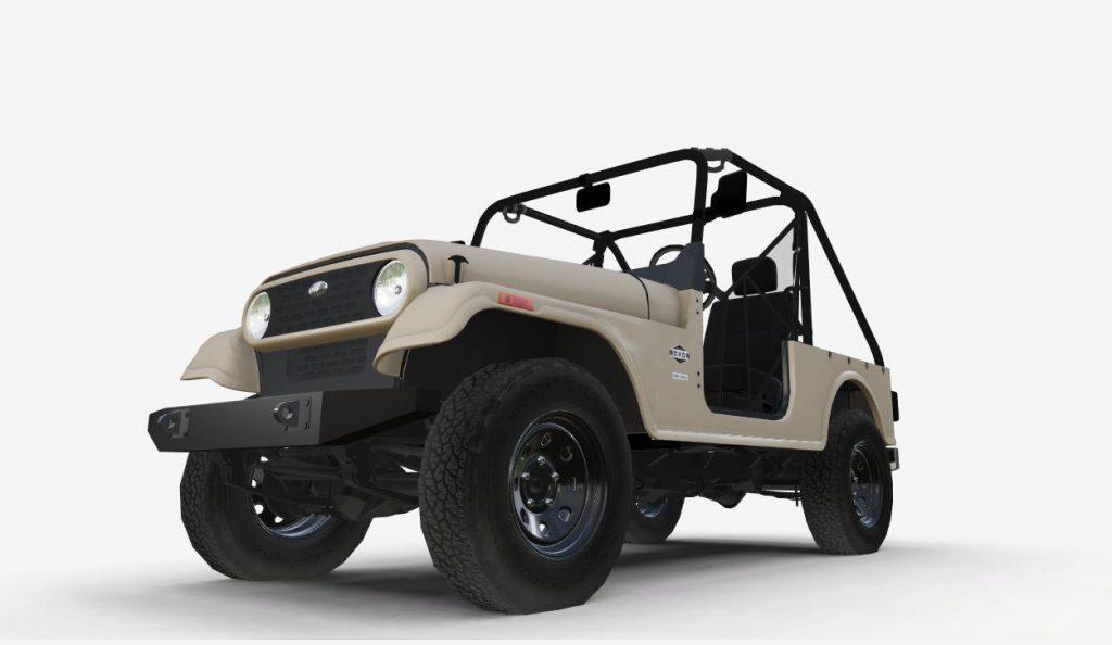 A tan 2020 Mahindra Roxor. Similarities to the Jeep Wrangler can't be denied.
