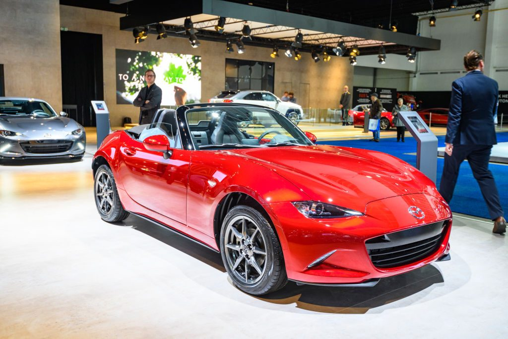 A red Mazda MX-5 Miata on display at an auto show
