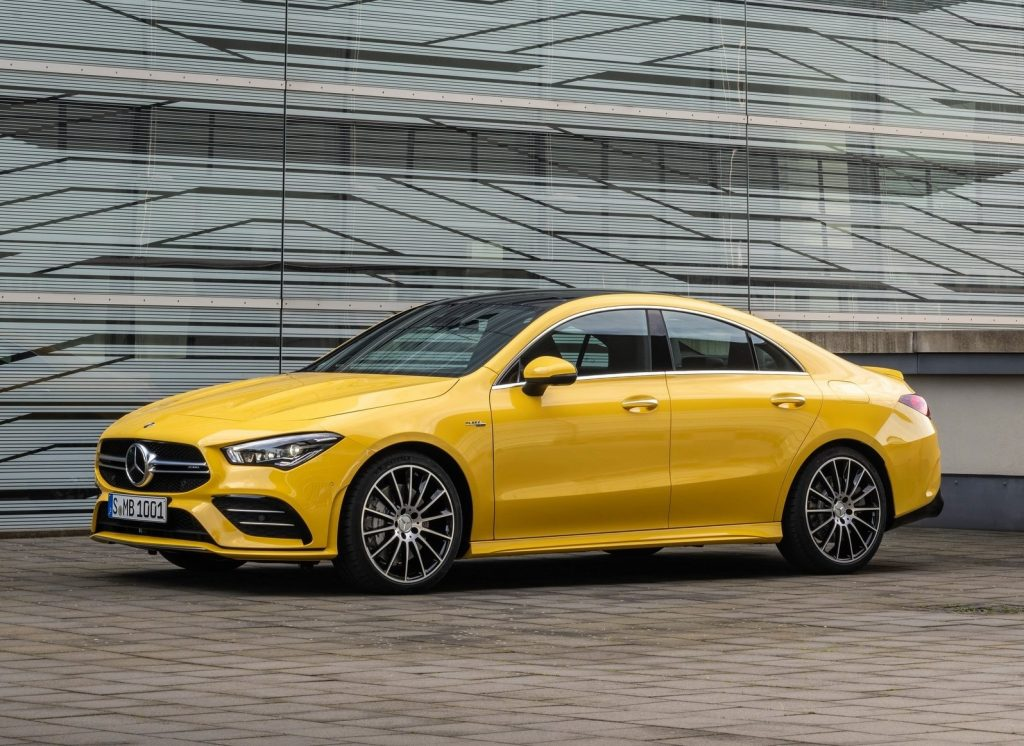 Yellow 2020 Mercedes CLA 35 AMG in front of a modernist building