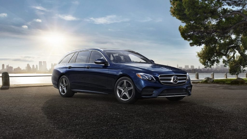 Dark blue 2020 Mercedes E450 4Matic Wagon parked in front of a city