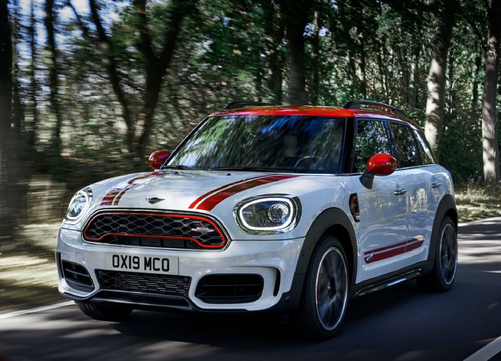White and red-striped 2020 Mini Clubman JCW driving down a forest road