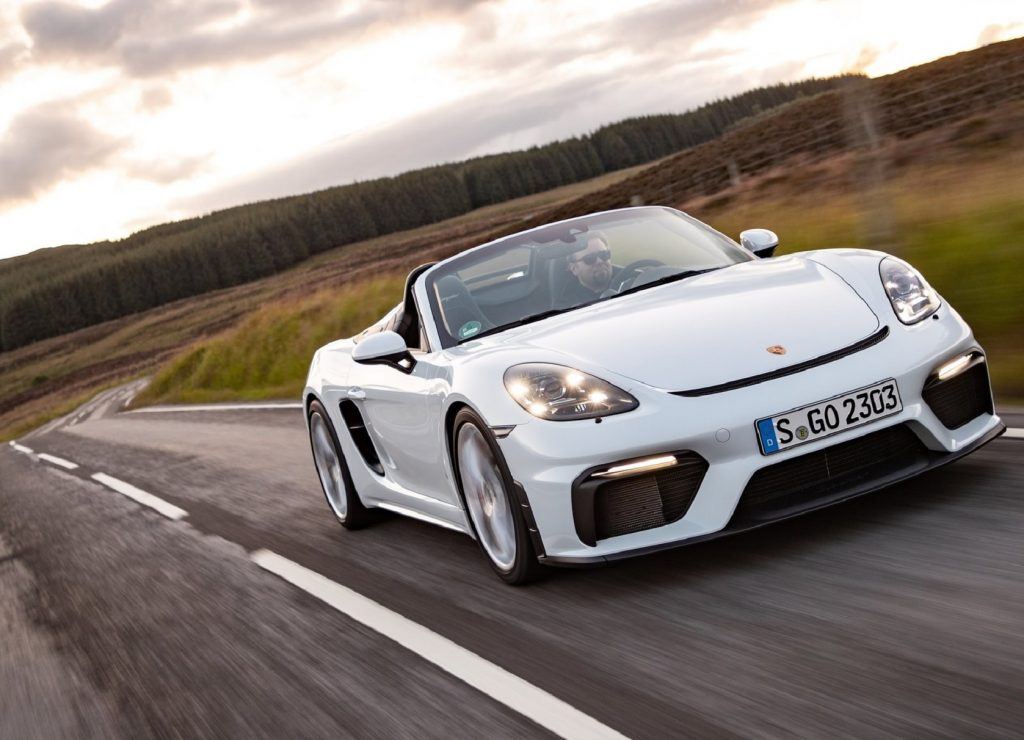 White 2020 Porsche 718 Spyder being driven down a curvy road