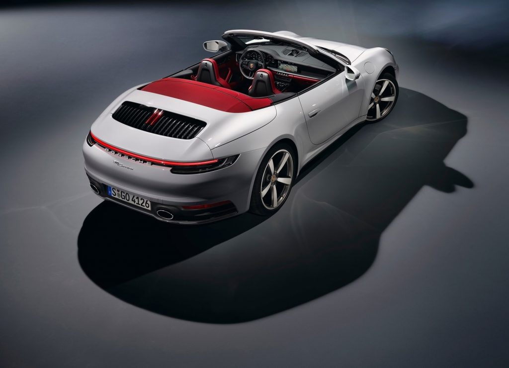 White 2020 Porsche 911 Cabriolet with red convertible top, seen from overhead