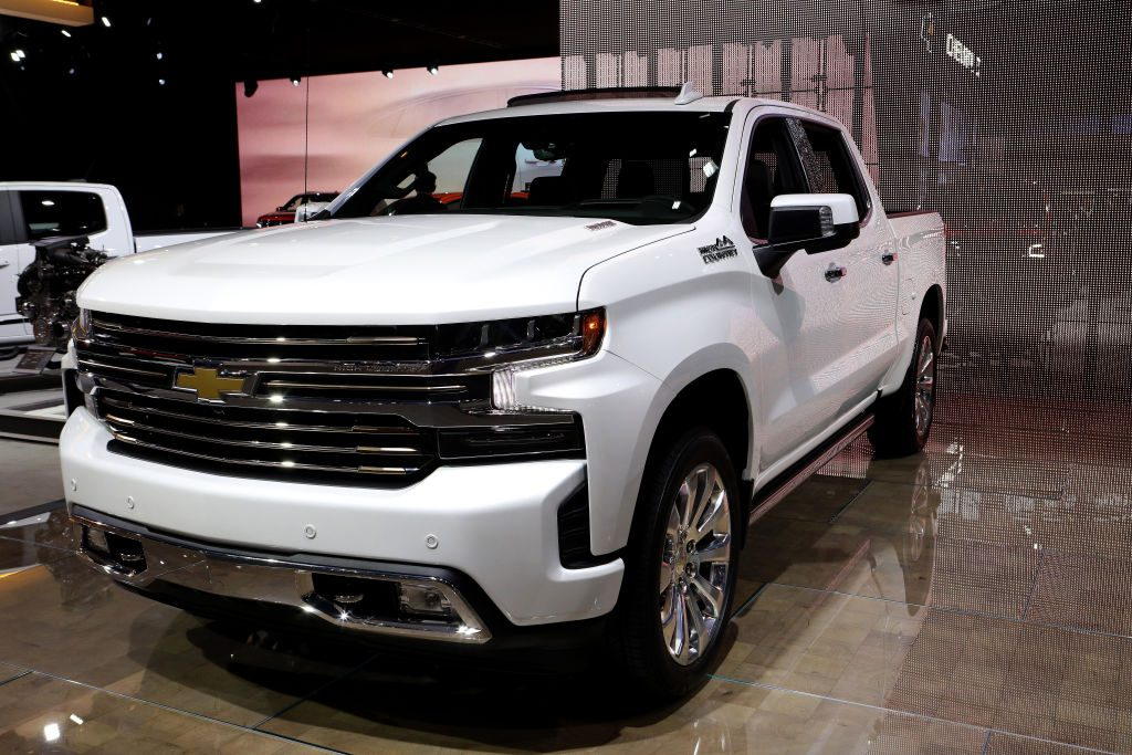 A white 2020 Chevy Silverado on display at an auto show