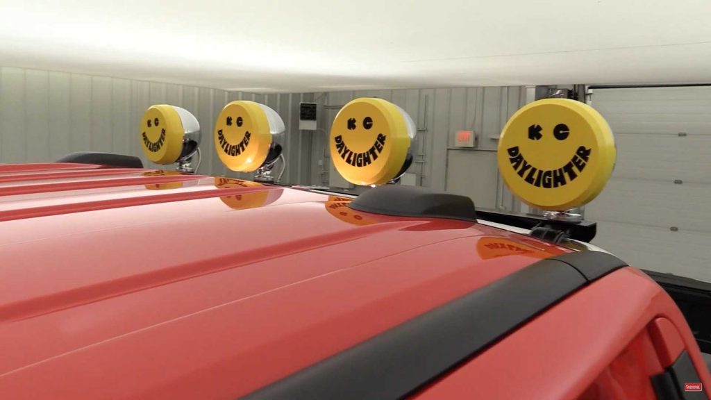 close up of Daylighter lamps on chrome roll bar with yellow happy face covers on them