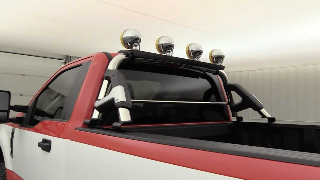 four Daylighter lamps on chrome roll bar on 2020 F250 Super Duty truck rear 3/4 view