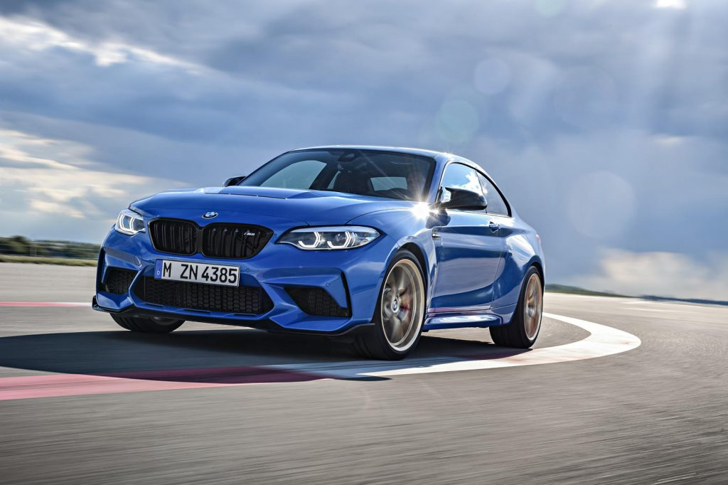 A blue 2021 BMW M2 CS taking a tight track corner
