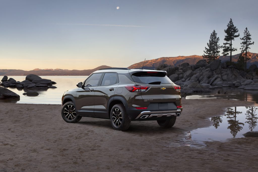 A 2021 Chevrolet Trailblazer sits on the banks of a lake at dusk.
