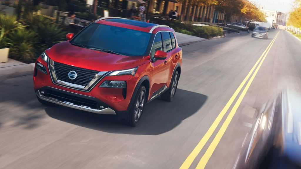 2021 Nissan Rogue in red on the street
