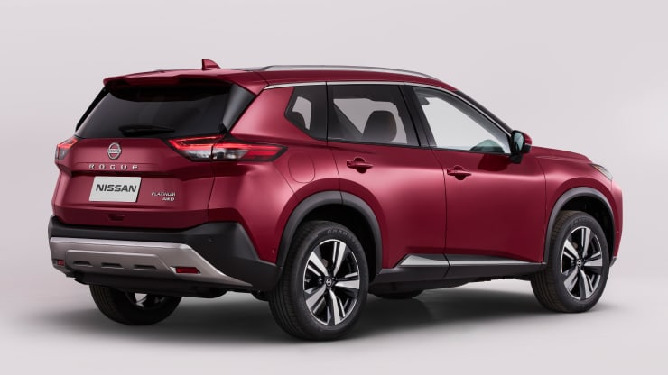 2021 Nissan rogue rear 3/4 shot in red in studio