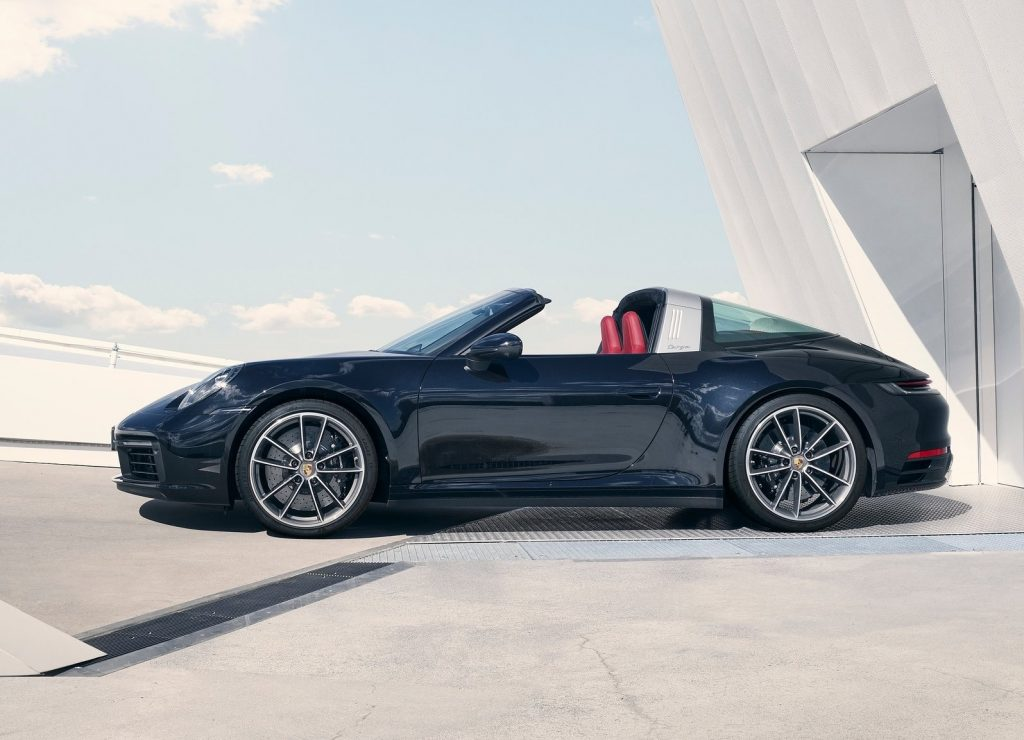 Side view of dark blue 2021 Porsche 911 Targa 4, with roof down