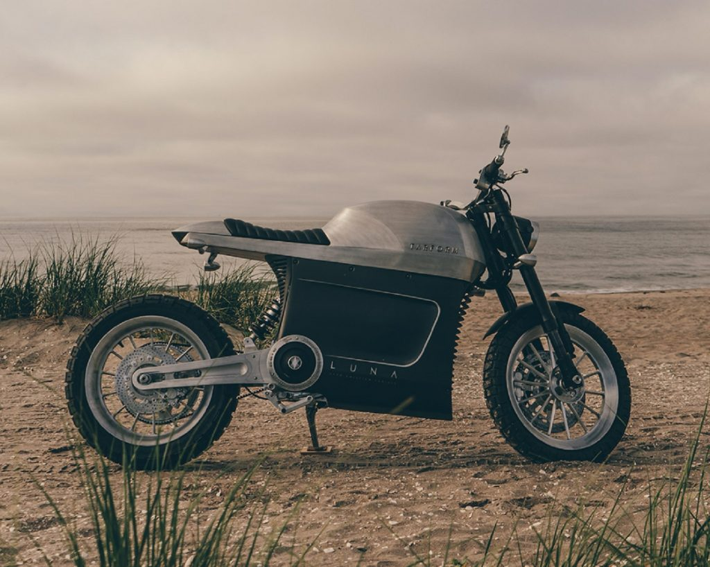 Brushed-aluminum 2021 Tarform Luna electric motorcycle on a beach