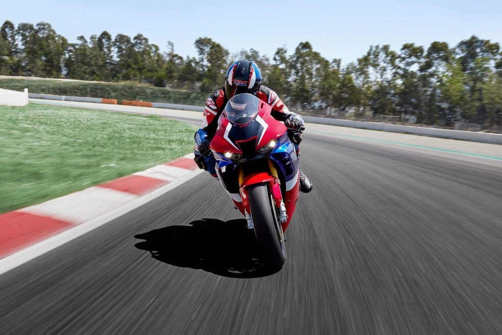 a front view image of a red, white, and blue Honda Fireblade sport bike