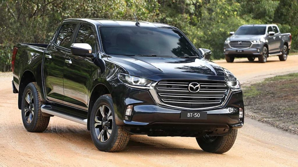 two 2021 Mazda BT-50 midsize pickup truck front 3/4 views