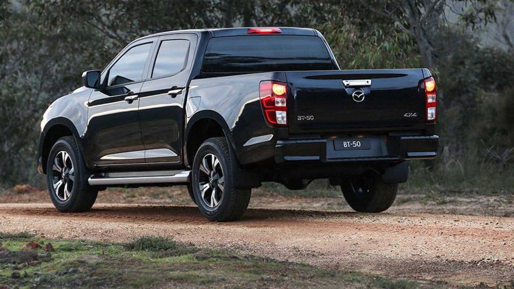Black 2021 Mazda BT-50 pickup truck rear 3/4 view
