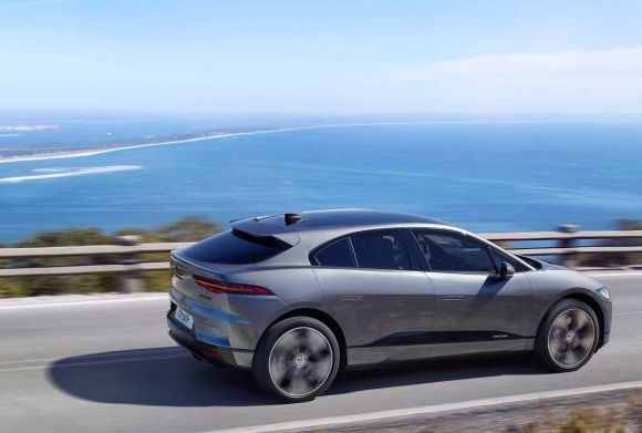 2021 Jaguar I-Pace rounding a hill rear 3/4 view