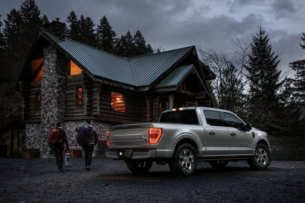 2021 Ford F-150 parked in front of cabin