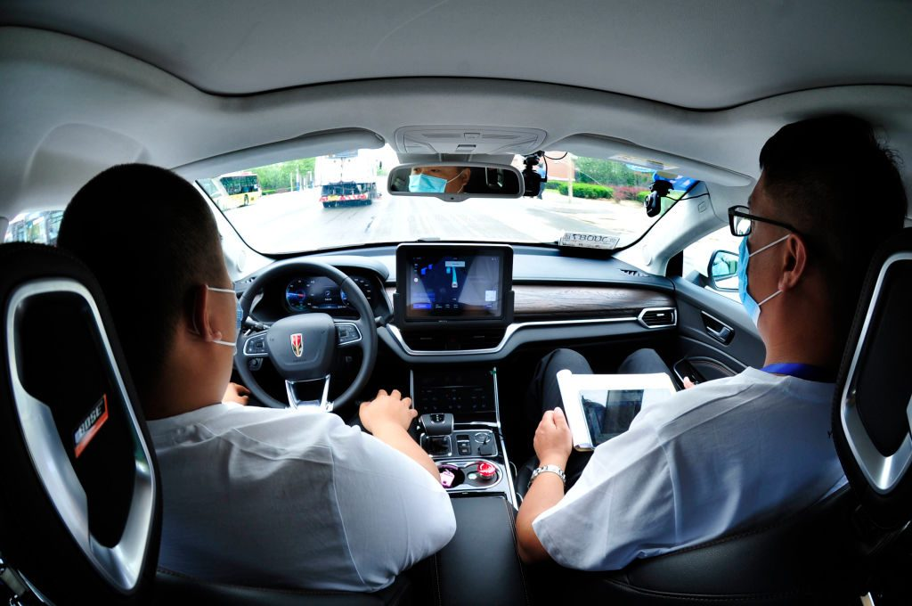 driver and passenger with all hands off of controls of car in autonomous driving experiment