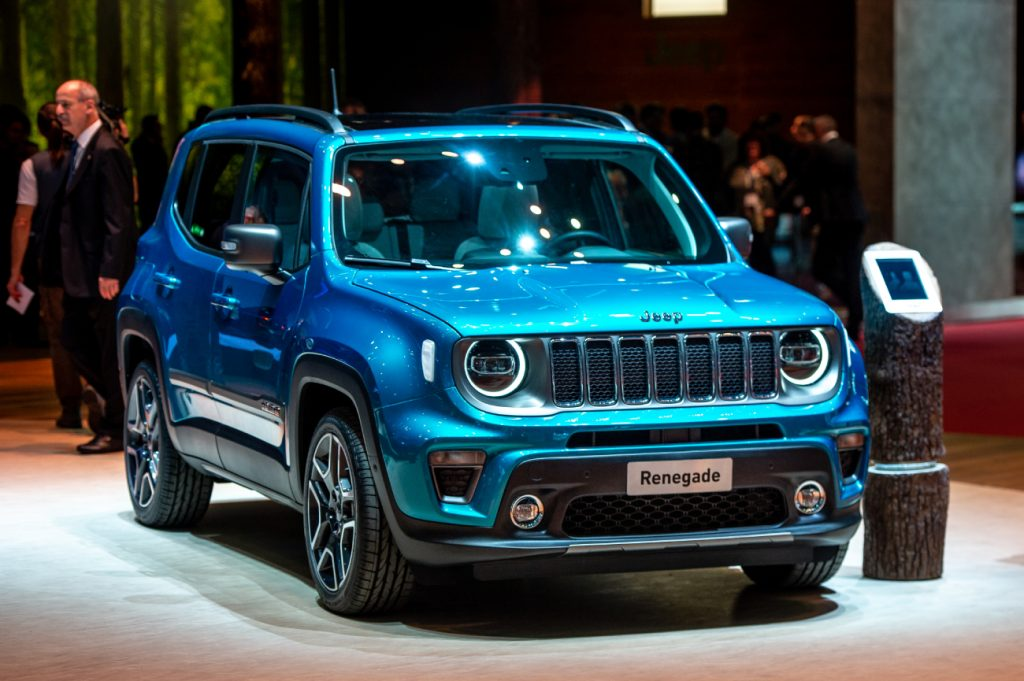 A blue Jeep Renegade on display at an auto show