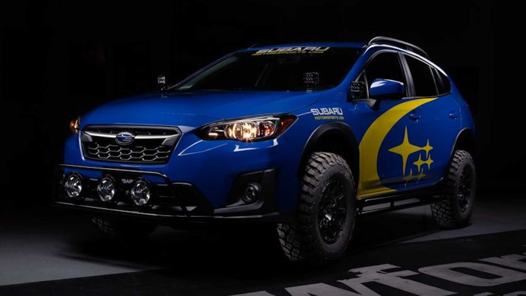 A blue Subaru Crosstrek with a Crawford Performance lift kit installed
