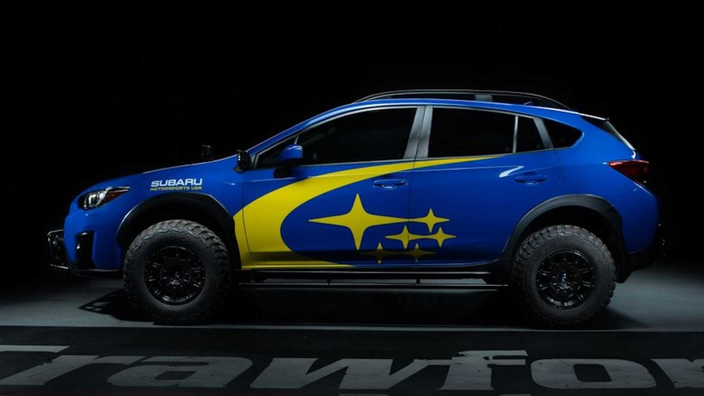 The profile of a blue Subaru Crosstrek that has been raised with a Crawford Performance lift kit