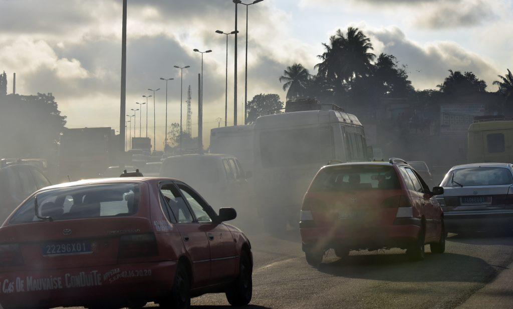 diesel truck spewing exhaust into traffic