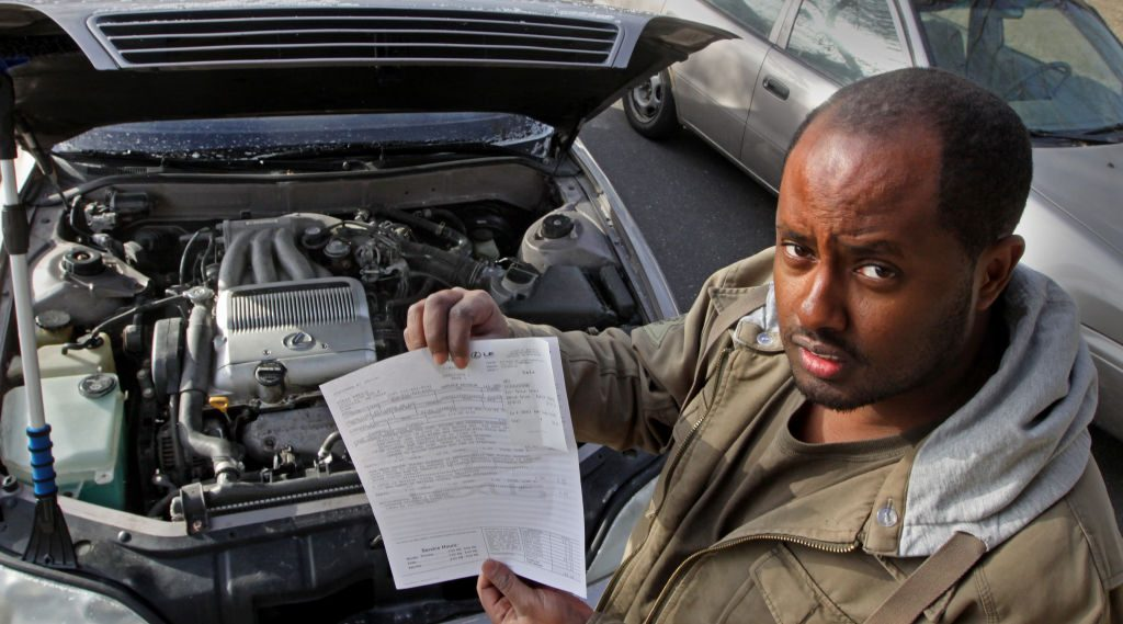 Man with bill for engine work