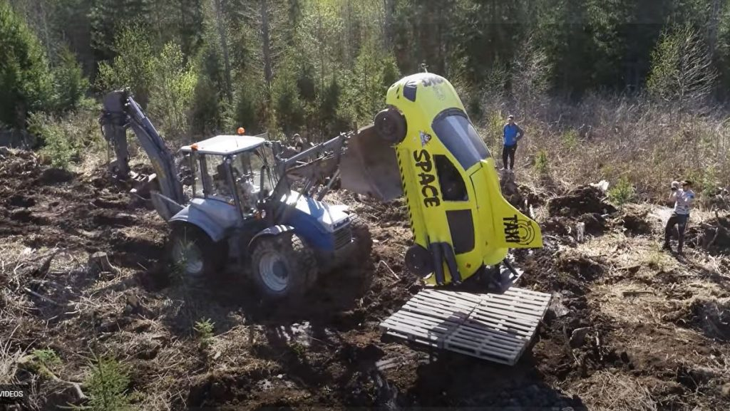 Beyond the Press Youtube channel used a tractor to load a yellow car onto a makeshift launchpad.
