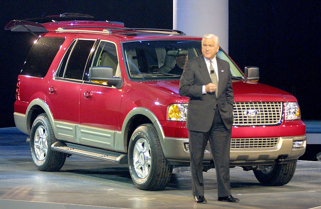 A man introducing a 2003 Ford Expedition on stage