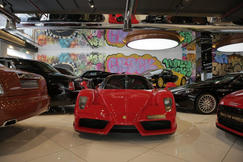 A picture looking head on at a red Ferrari Enzo