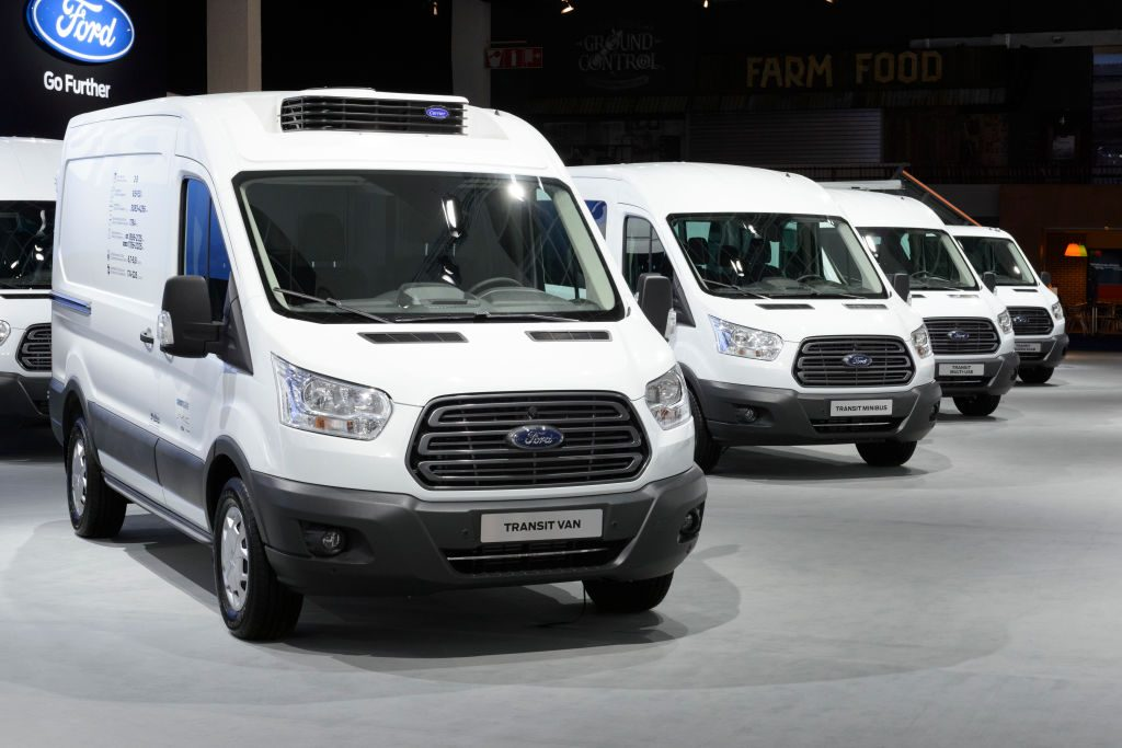 white Ford fleet vans on display
