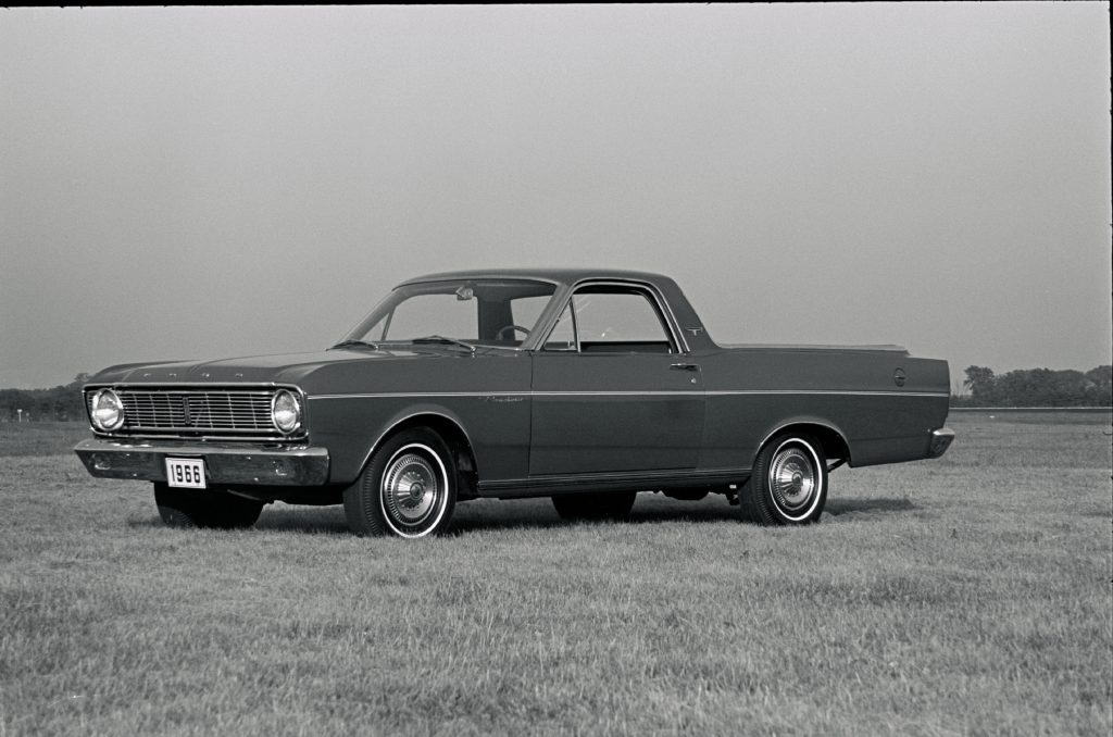 A 1966 Ford Ranchero sitting in a field