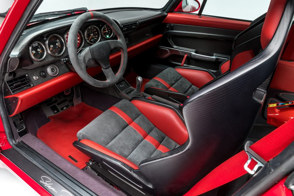 Black-and-red Gunther Werks 400R interior, with carbon-fiber bucket seats with red bolstering