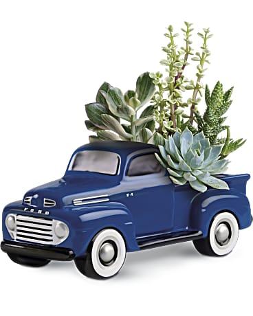 a pickup truck pot full of succulents