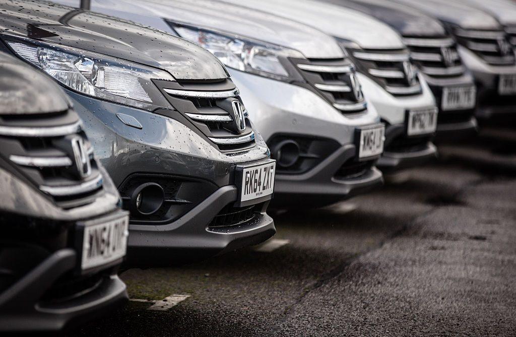 A row of Honda cars at a dealership