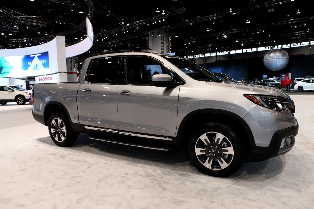 A silver 2020 Honda Ridgeline on display at an auto show