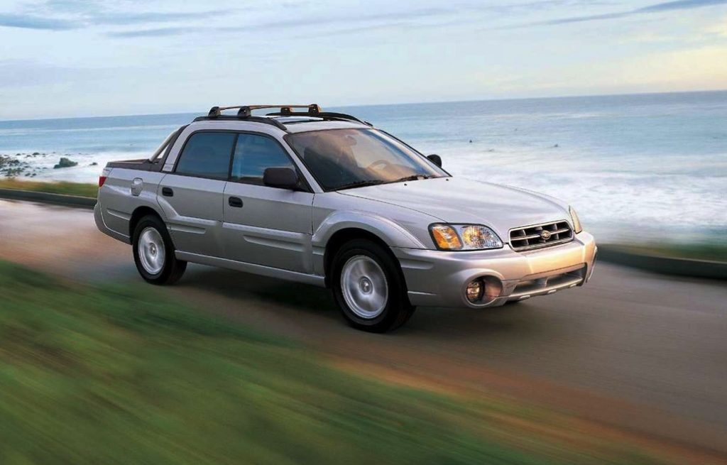 a Subaru Baja utility truck driving along the coast
