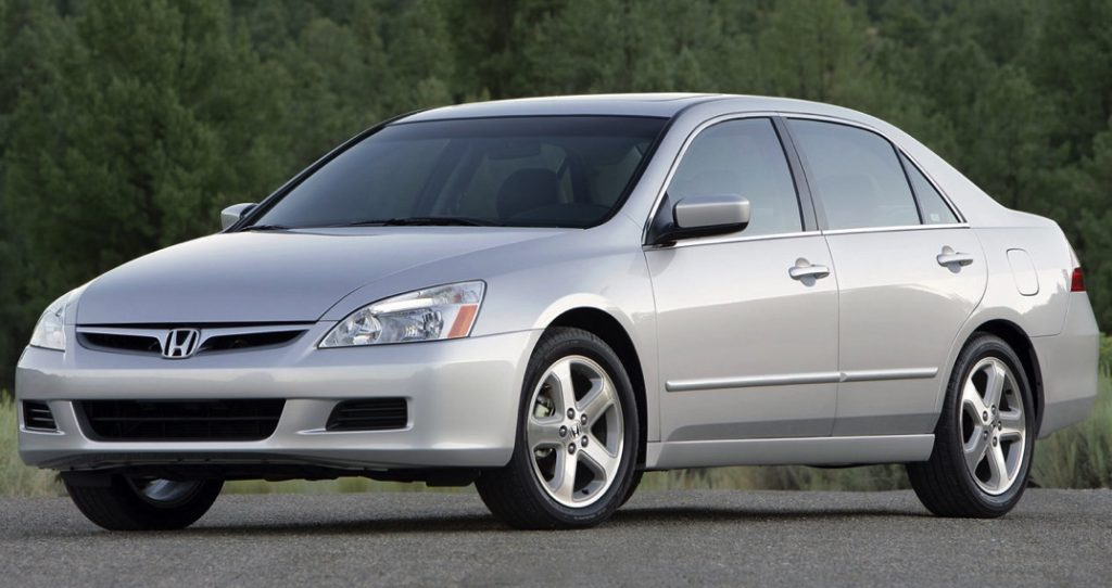 an older silver Honda Accord sedan