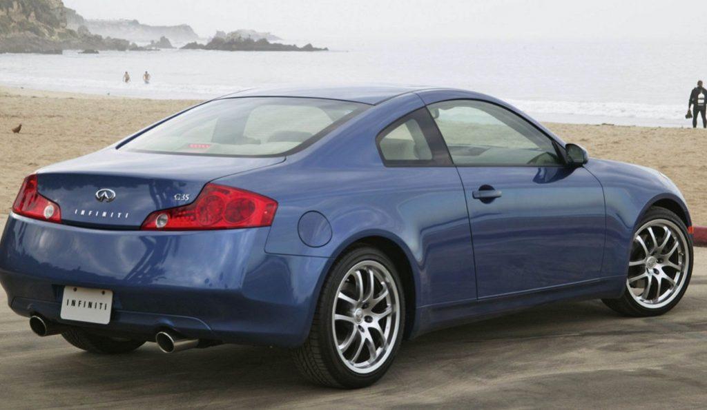 a blue Infiniti luxury sports car on the beach