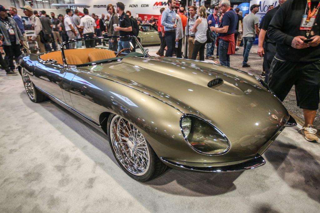 A gold custom Jaguar E-type sits on the SEMA showfloor