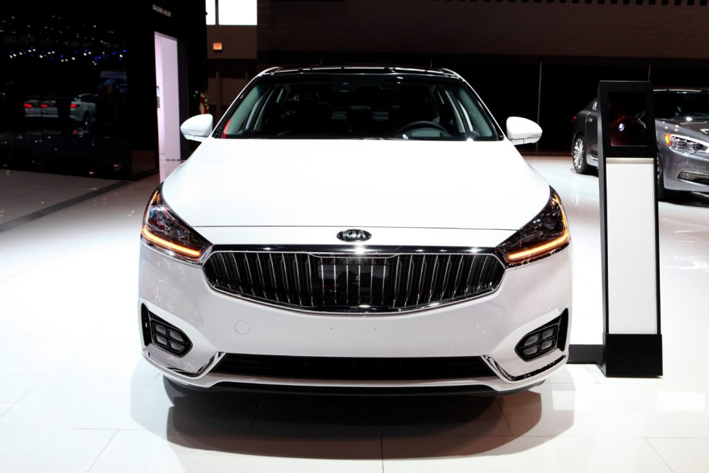 A Kia Cadenza seen from the front at an auto show
