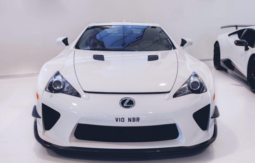 A white Lexus LFA on display at an auto show