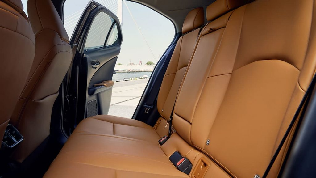 The UX's back row with tan leather seats.