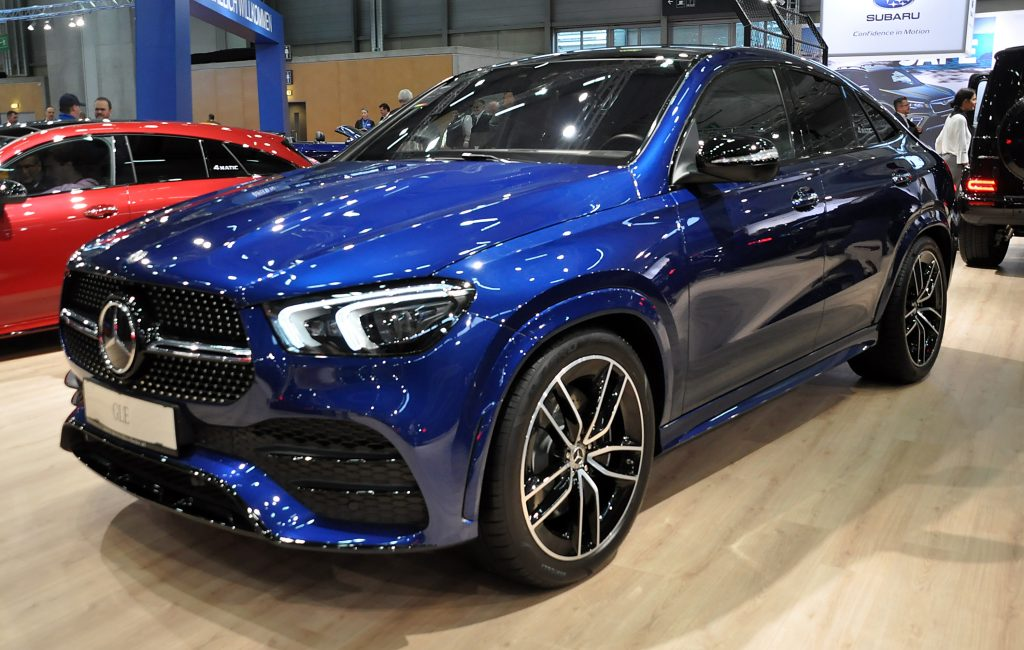 A blue Mercedes-Benz GLE on display at an auto show