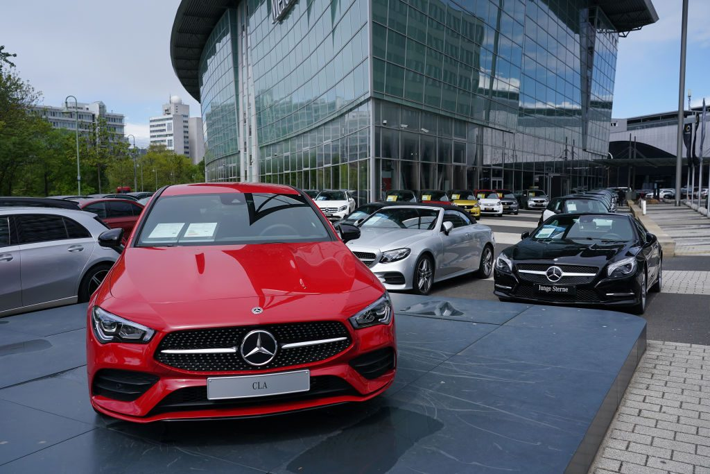 Cars stand on display for sale at a Mercedes-Benz dealership during the coronavirus crisis
